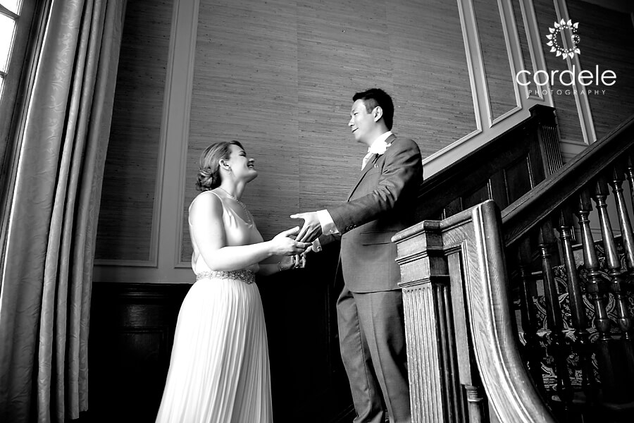 A bride and groom have a first look on a stair case