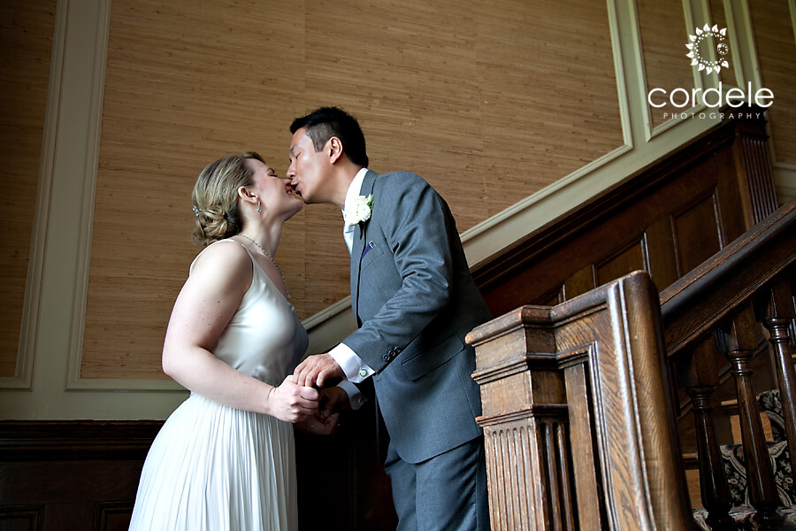 A groom kisses a bride after seeing her for the first time.
