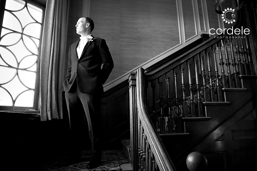 Groom waiting on staircase