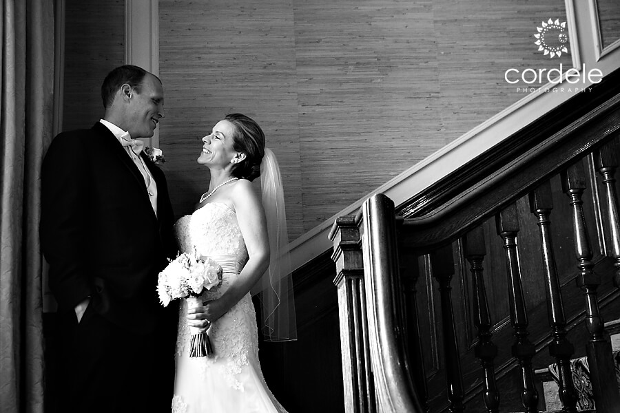 This is a window lit portrait of the bride and groom seeing each other for the first time. At the Endicott Estate, it's such a great spot for a first look. You hve directional light and then you can have the groom turn, while keeping a photographer up at the top of the stairs.