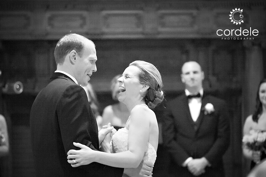 A black and white photo of a a husband and wife having their first dance at the Endicott Estate