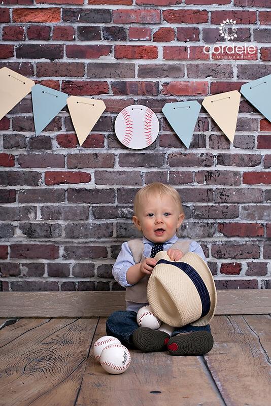 little boy holding a fedora