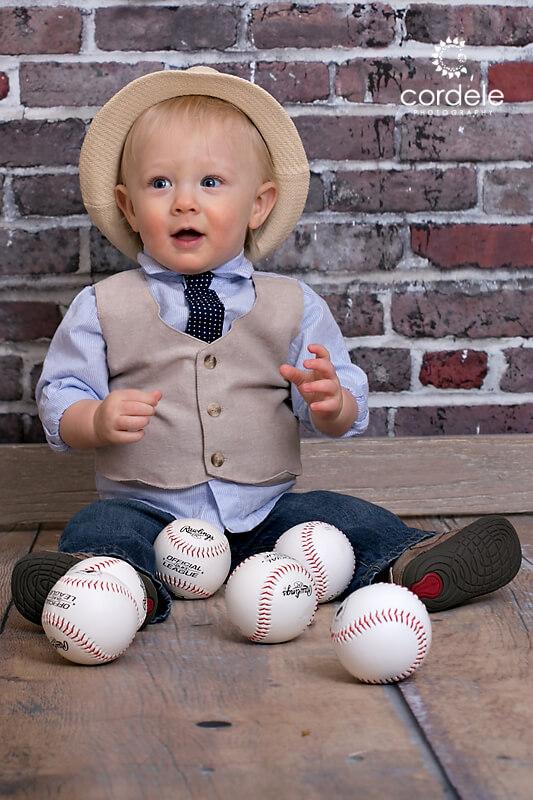 Little boy wearing a fedora hat