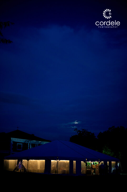 A night time photo of a tented wedding at Codman Estate in Lincoln Ma