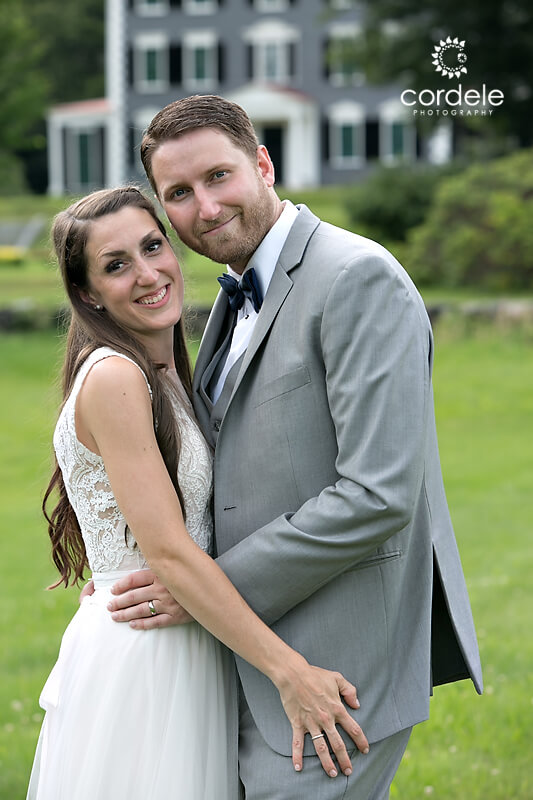 Photo of bride and groom in front of Codman Estate