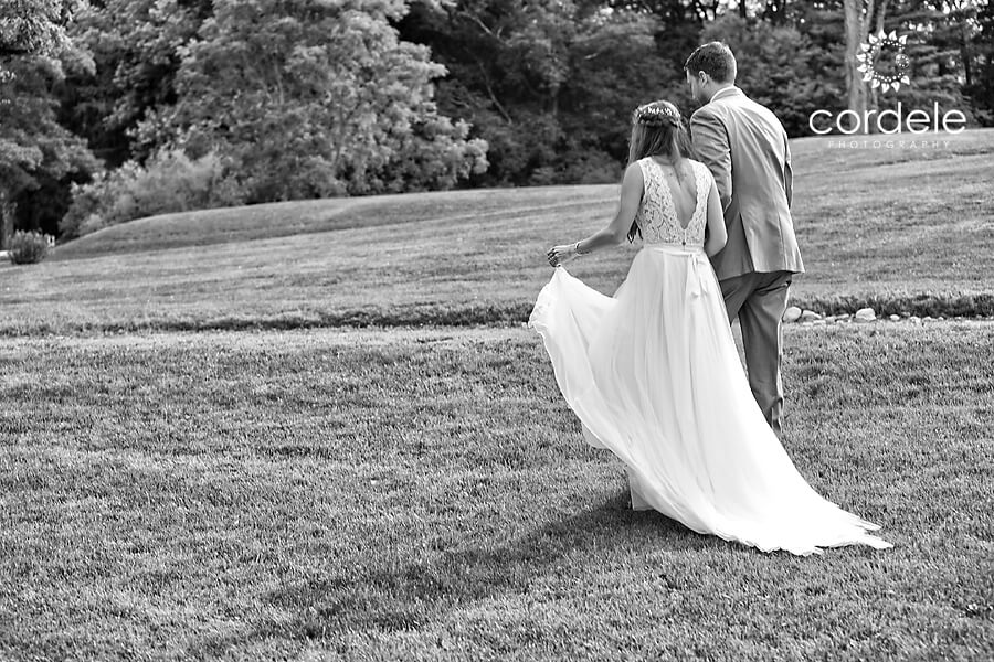 Bride and Groom walking at Codman Estae