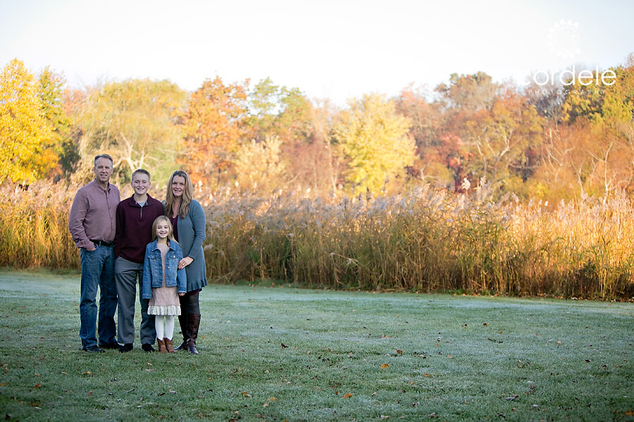 A family portrait in a field