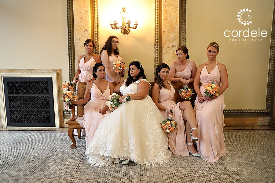 Bridal party sitting on bench inside providence public library