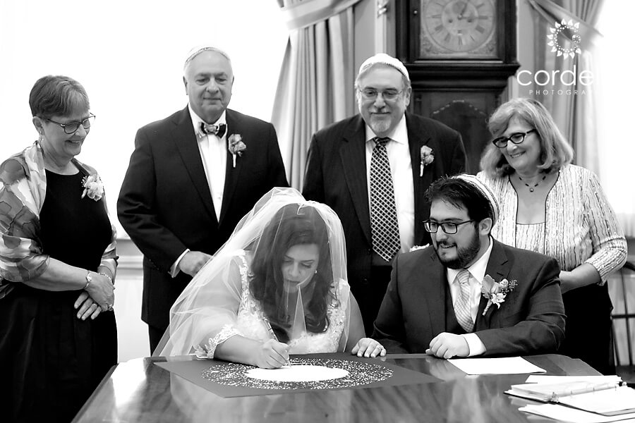 Could tuba signing black-and-white photo