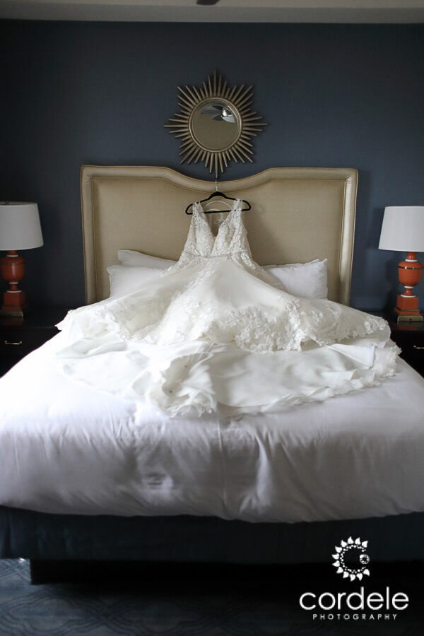 A bridal dress hands on a headboard at the Providence Biltmore Hotel