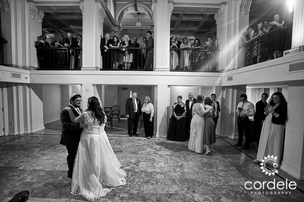 Black and White photo of a bride and grooms first dance as husband and wife