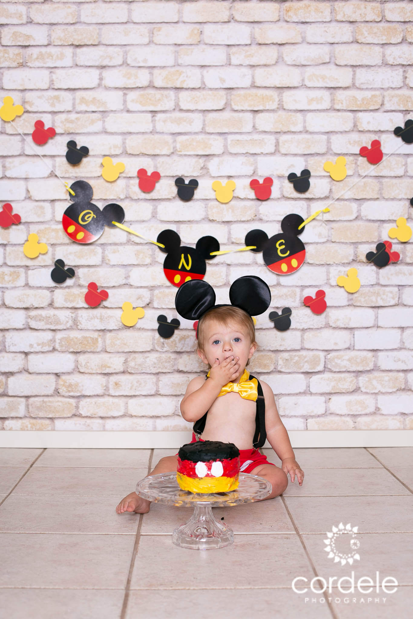 A cake smash with Mickey Mouse