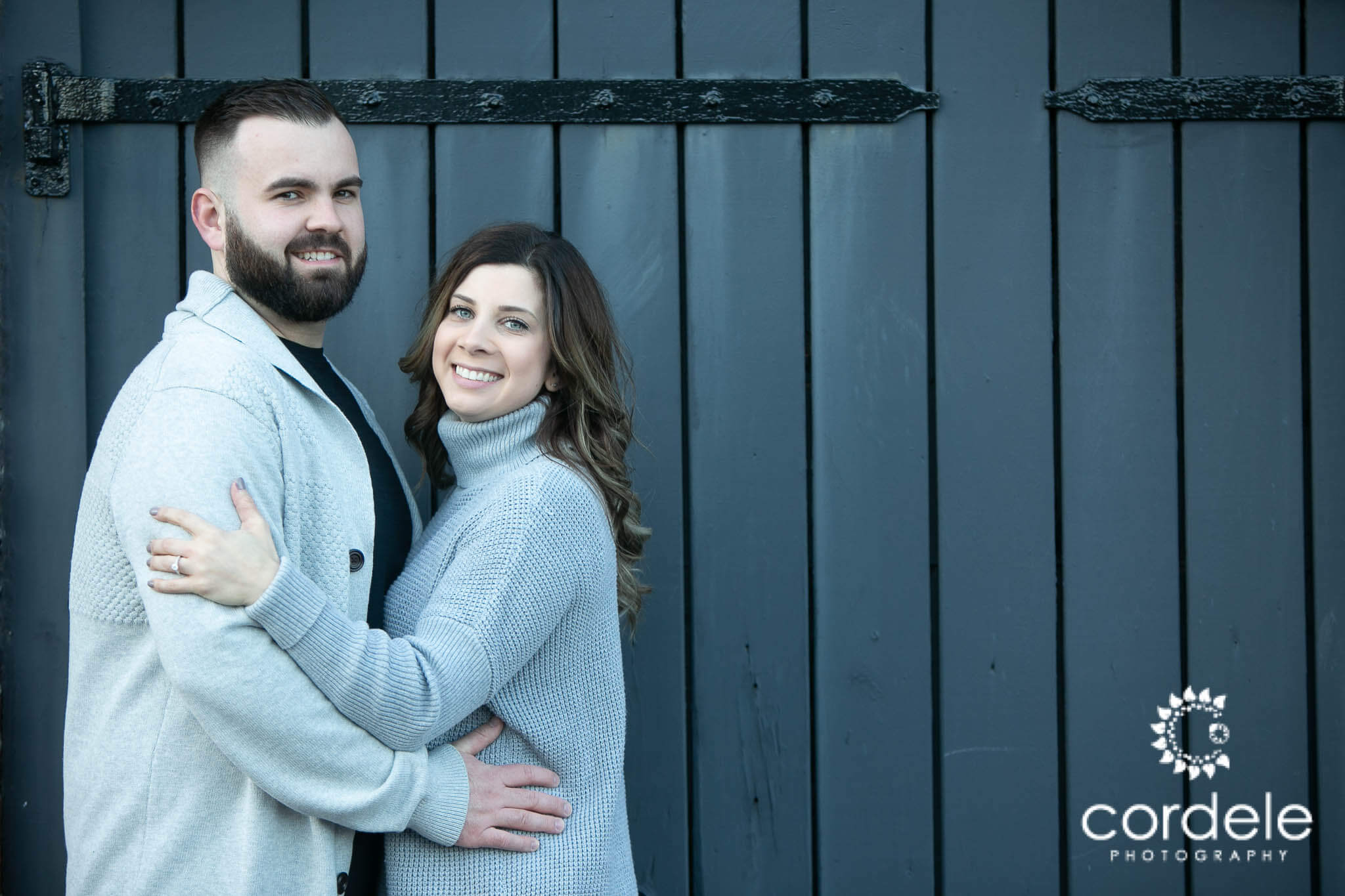 Couple in Boston stands for engagement photos